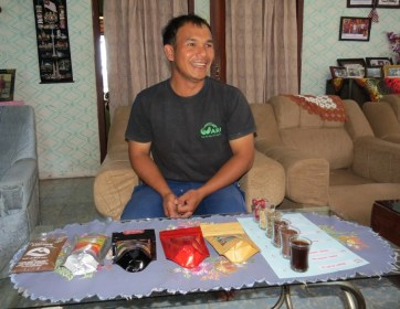 Gani with his packaged coffees