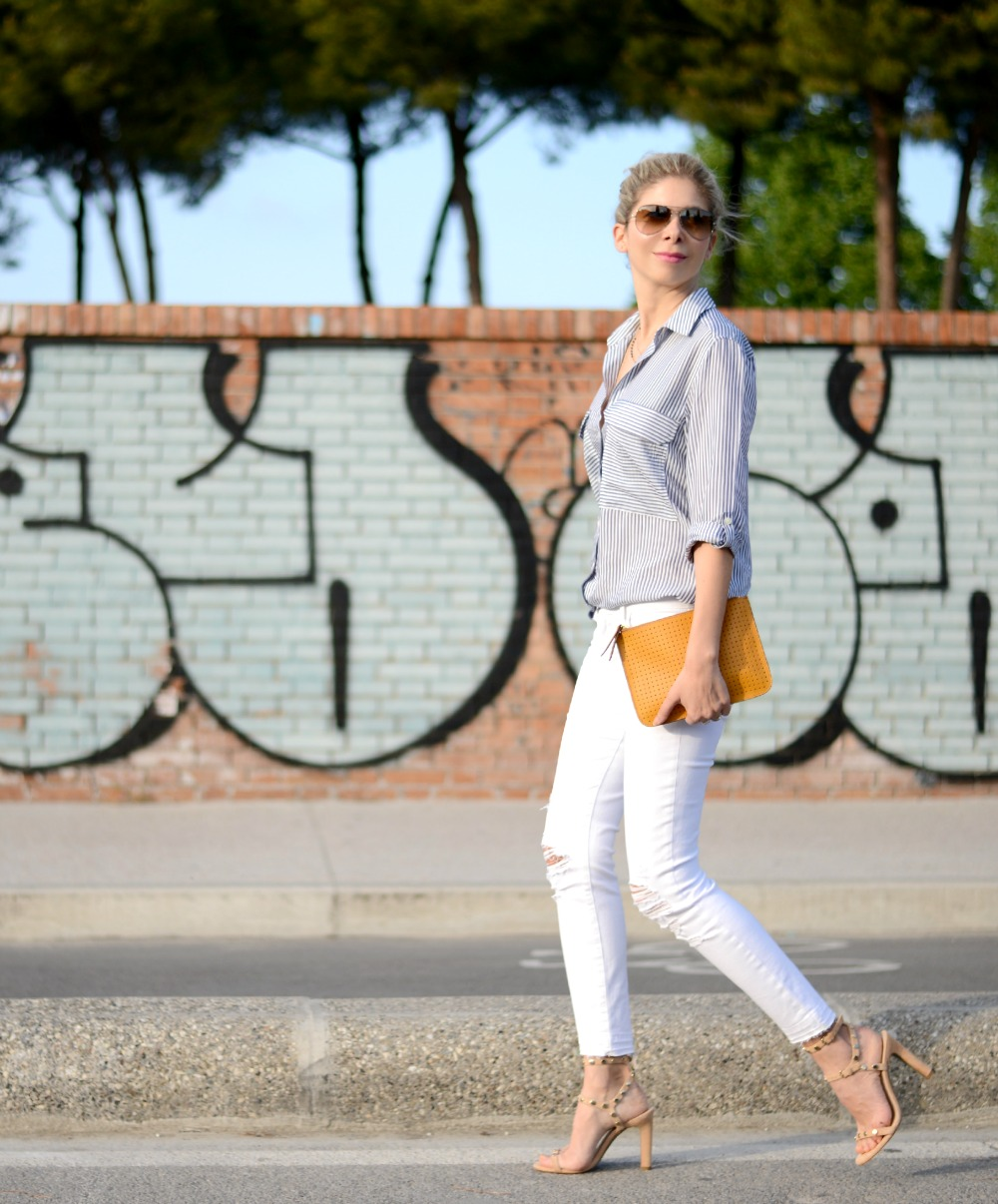 Brand white ripped jeans, stripped shirt, nude sandals, street style.