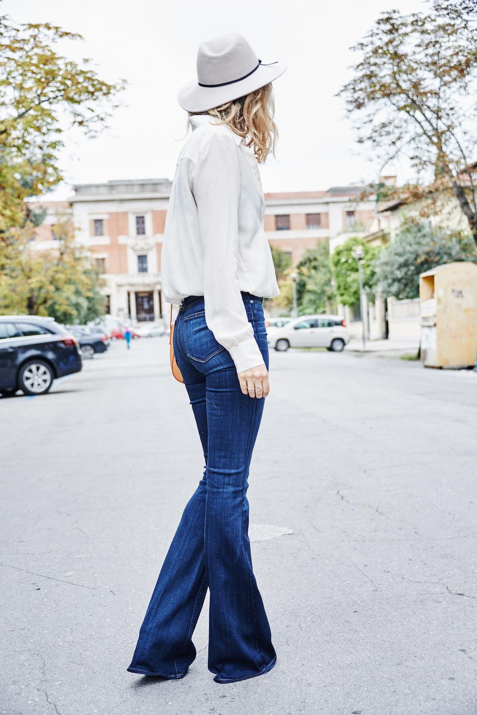 Wearing Paige flared jeans, Zara shirt, Mansur Gavriel bag and Reiss fedora hat.