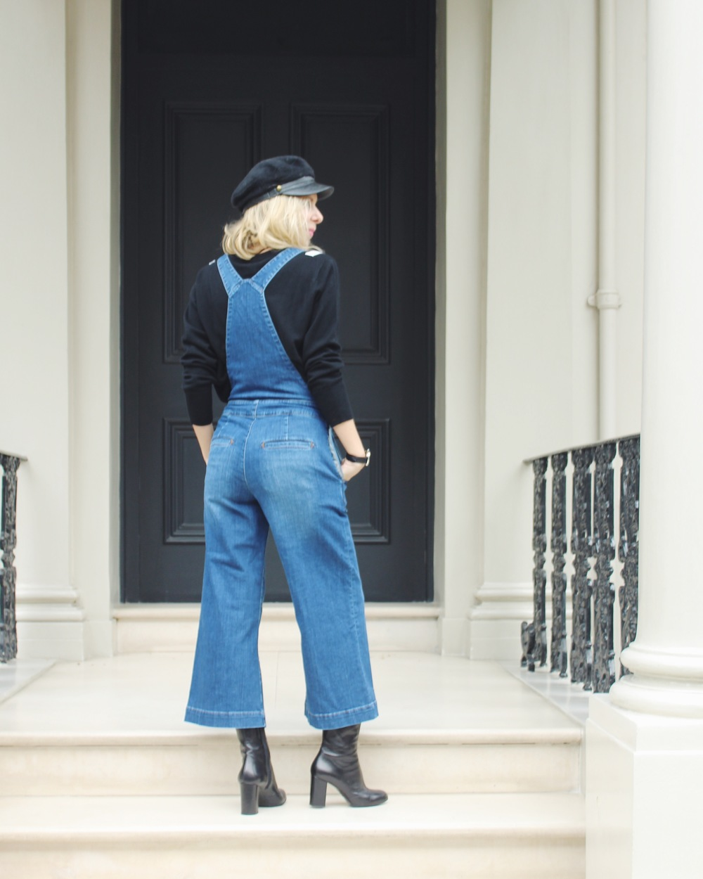 Arianna Trapani wearing the Donna Ida Ramona denim culotte pinafore paired with Baker boy hat, sock boots.