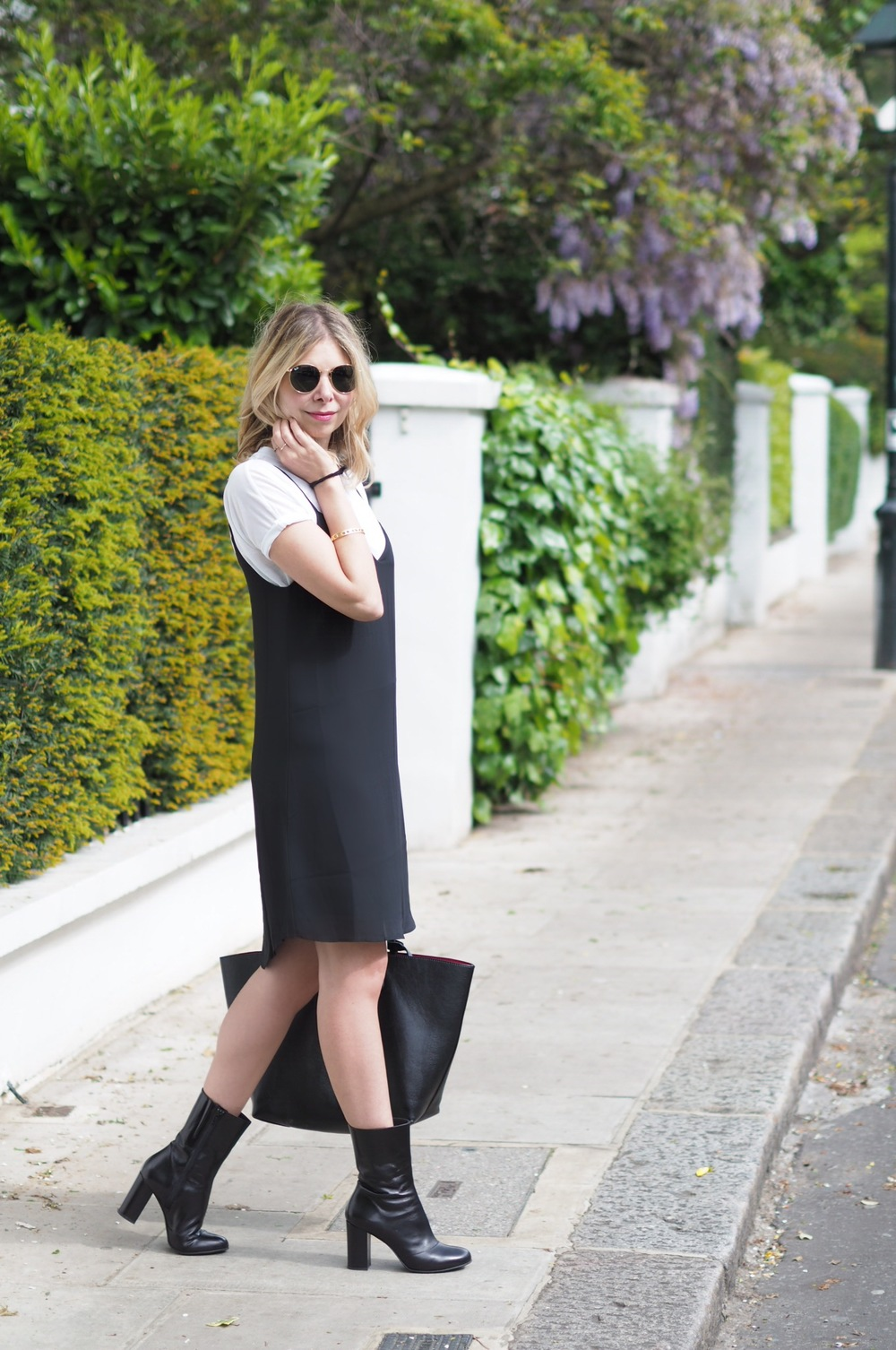 Arianna Trapani wears Camisole dress from Sincerely Jules, White t.shirt from COS, Ankle boots from Russell & Bromley, Sunglasses from Rayban, Bag from Zara and necklace from Missoma.