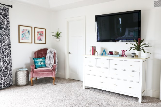 One Room Challenge Beachy Glam Master Bedroom Reveal: vintage wing back chair; jewel tones, glam, boho, beachy; vintage pink velvet chair, velvet chair in corner, abstract art