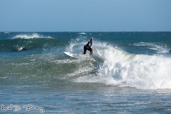 Surfer doing some twist thing