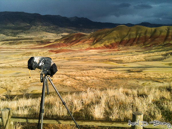 Camera with raingear at the painted desert