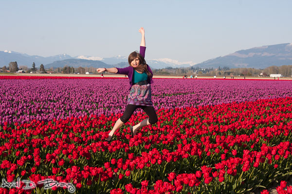 Anna jumping in the fields