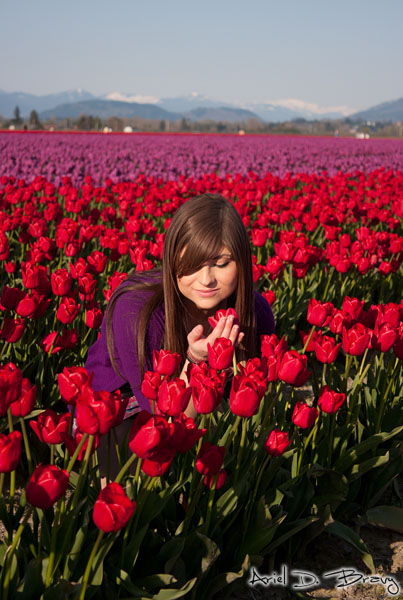 Anna smelling a tulip