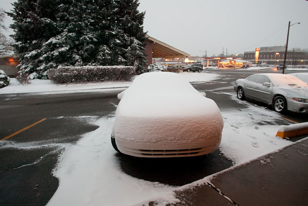 Snow covered car looking goofy