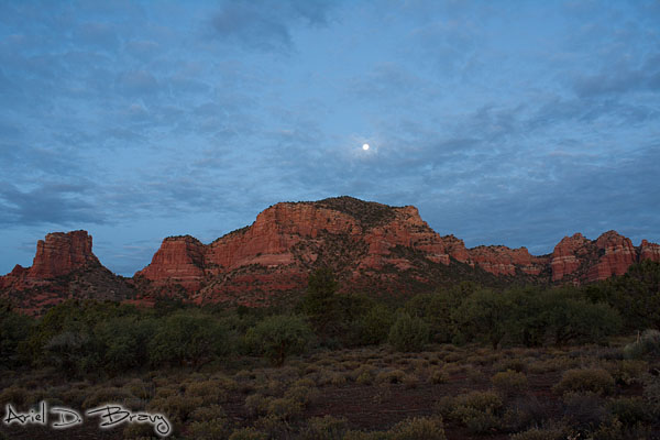 Moonset just before sunrise near Bell Rock