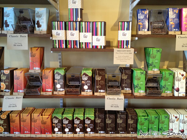 Colorful shelves of Theo's chocolate bars and free samples