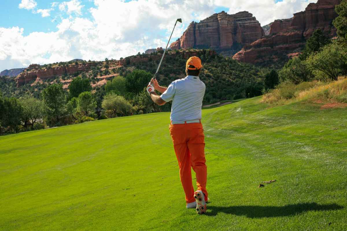 photography of man playing golf