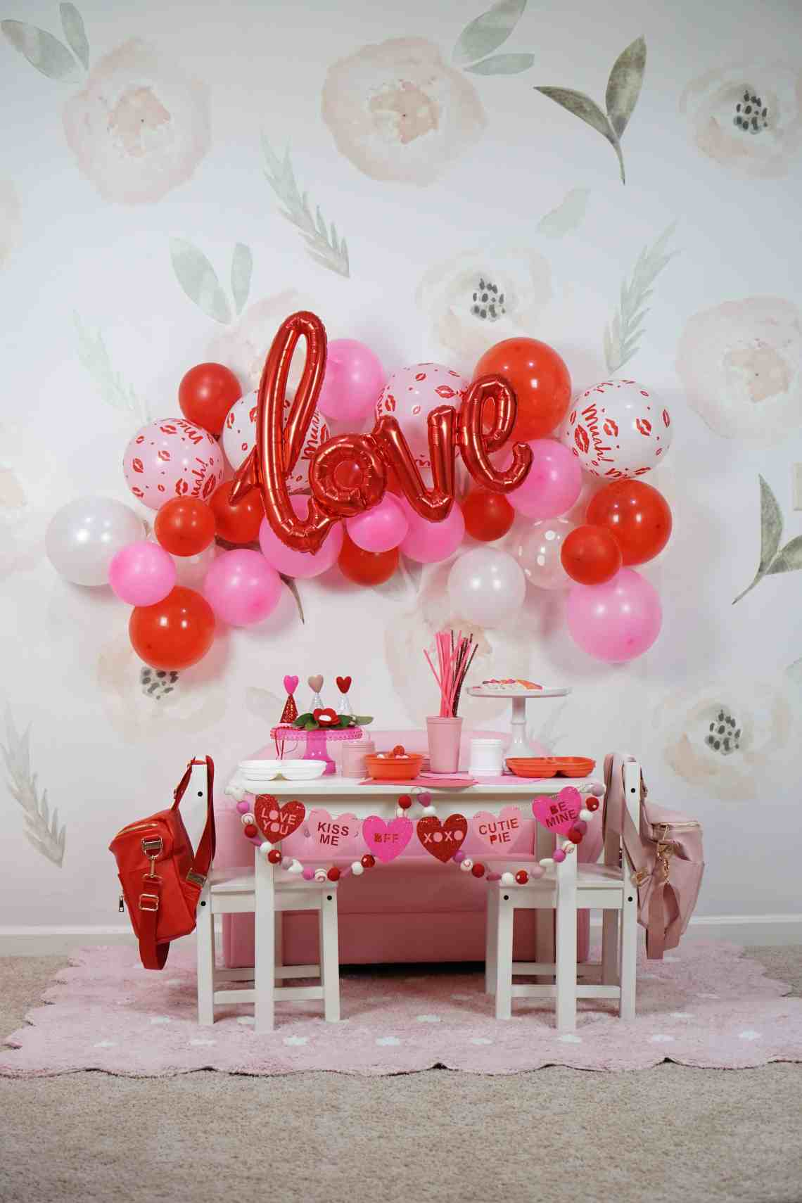 pink and red balloons and table scape with toddlers
