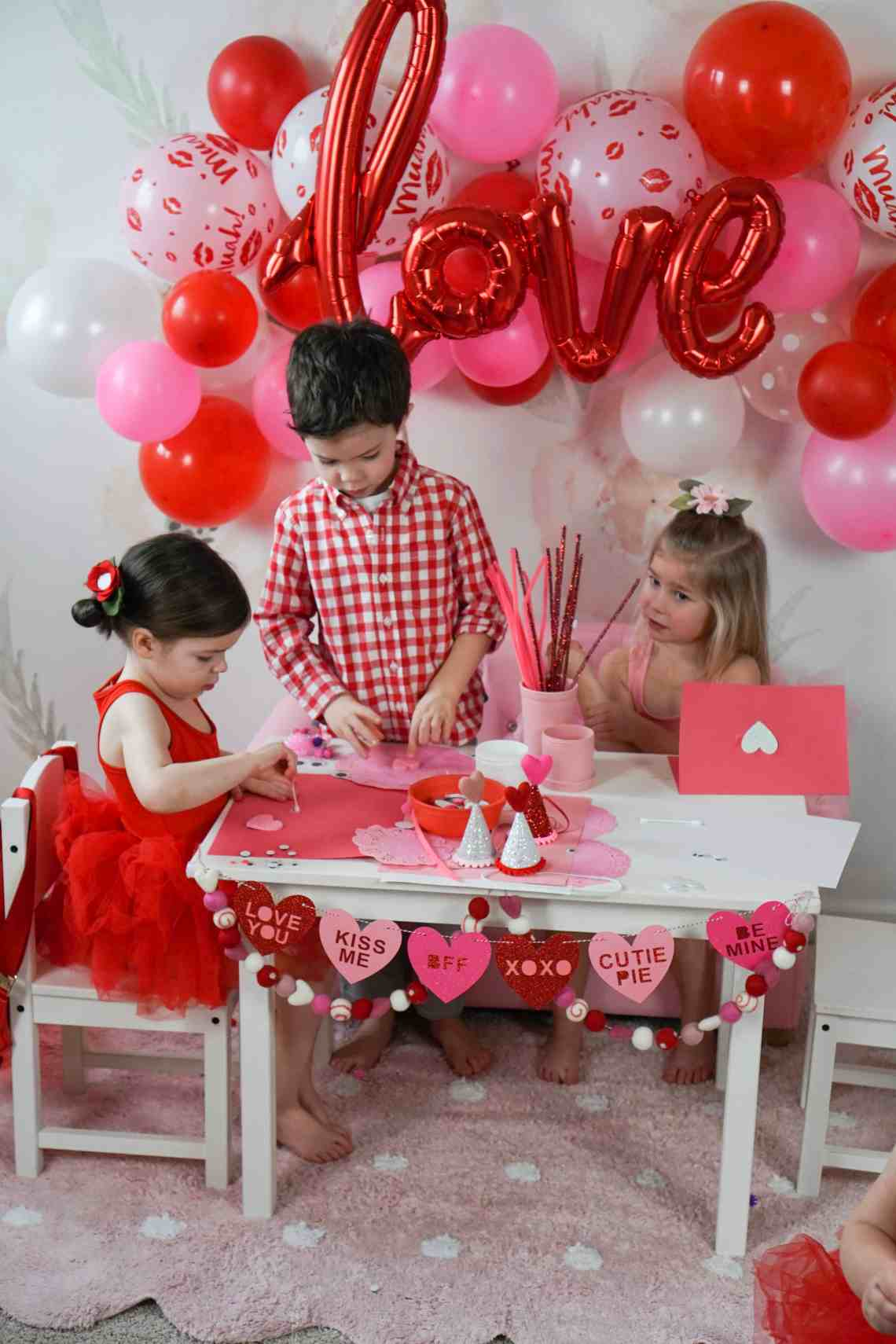 toddlers doing a valentines day craft