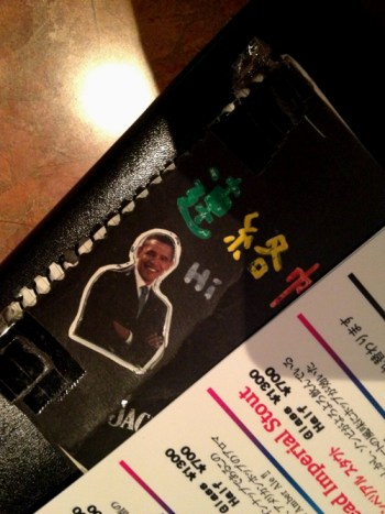 A cutout of Barack Obama on the cover of an address book.