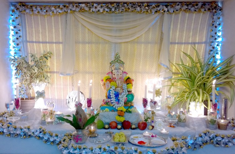 diy ganpati decoration with glasses and candles one brick at a time