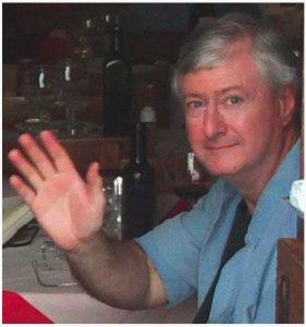 Photo of Patrick Carroll in a restaurant in Montefalco, Italy, 2010.