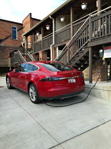Photo of a Tesla car charging at the guesthouse.