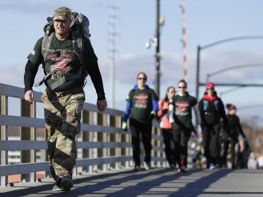 In this USAT Network File Photo, Staff Sgt. Frank Badillo-Beyer walks 22 miles in a