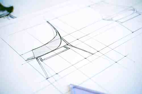 A chair sketched on a piece of paper highlighting the side view. Lines mark the important points of the chair's measurements.