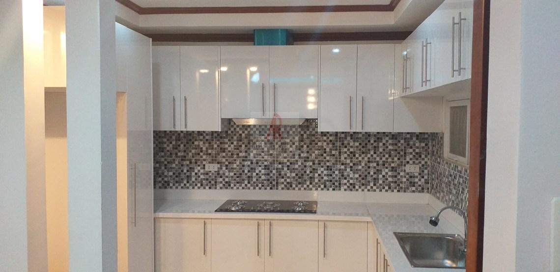 GLossy White kitchen with white quartz countertop