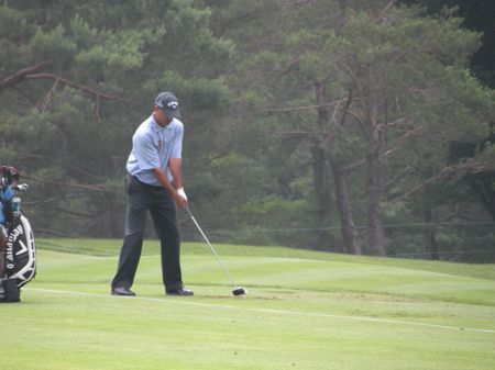 PGA Tour Pro James Nitties practices his swing in the driving range area at the tournament.