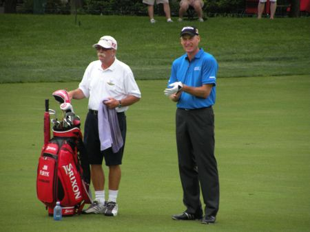 """Jim Furyk and his caddy, Mike """"Fluff"""" Cowan, discuss the 13th green during the June 1 practice day at the Memorial Tournament."""