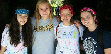 Juniors Elizabeth Tzagournis, Allee Overmyer, Marky Dieker and Bonnie Igel pose for a photo during camp. Applications to be a camp counselor are available in spring 2012.