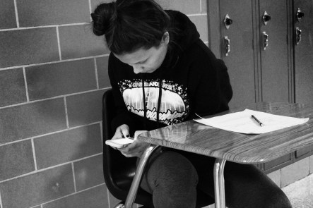 Student cheats on test by using a phone. A picture of an AP U.S. History test circulated around the sophomore class during a recent cheating scandal.