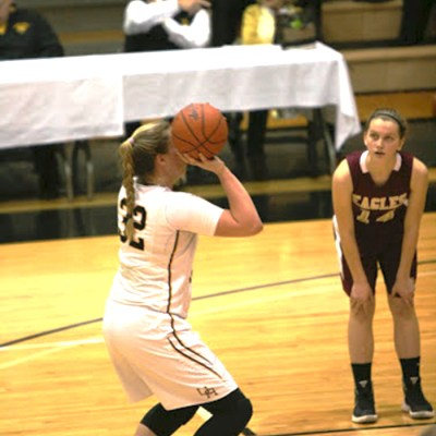 Senior Kortney Eisenman prepares to shoot a basket on Feb 27 at the district finals against New Albany. It was a close game for the girls, with the final score of 59-47.