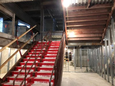 Staircases and classrooms under construction.