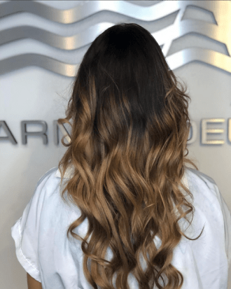 Hair extensions and color done at Salon Armandeus Weston