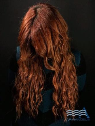 Copper hair color and extensions done at Salon Armandeus Doral