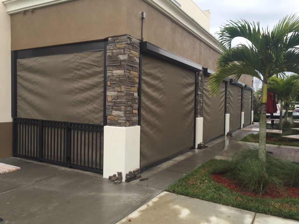 Pros And Cons Of Roll Down Shutters And Hurricane Fabric For