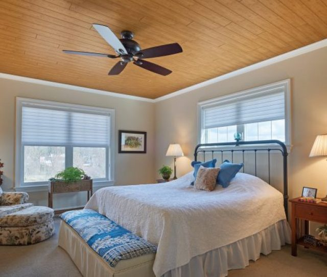 Quaint Bedroom With Wood Look Ceilings