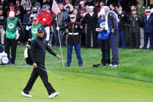 Monterey military s public role in PGA golf tournament    Article     PEBBLE BEACH  Calif    Tiger Woods prepares to putt at Pebble Beach s 15th  hole
