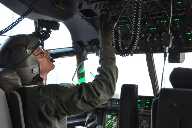 Lt. Col. Timothy Weiher, a pilot with the 815th Airlift Squadron based at Keesler Air Force Base, Mississippi, equipped with night vision goggles, prepares to fly a training mission to drop paratroopers from the 160th Special Operations Aviation Regiment to establish a Forward Army Refueling Point in support of the Operation Southern Strike exercise in South Mississippi Oct. 29, 2014. The 815th AS is an Air Force Reserve unit stationed at Keesler Air Force Base, Mississippi.The 160th SOAR is headquartered in Fort Campbell, Kentucky. (U.S. Air Force photo/Master Sgt. Brian Lamar)