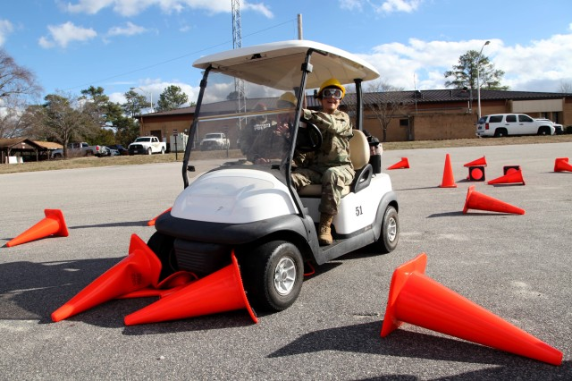 """A Soldier, wearing vision distorting """"drunk goggles"""" meant to simulate a blood alcohol content between .08 and .15, grinds a golf cart to a halt, unable to proceed further down a simple cone course, Jan. 12, 2017. The Fort Bragg Provost Marshall Office Traffic Division assisted 7th Military Information Support Battalion, 4th Military Information Support Group, to conduct an alcohol awareness safety class to raise awareness of alcohol's rapid effects and to deter drunken driving. (U.S. Army photo by Capt. Stephen Von Jett/Released)"""