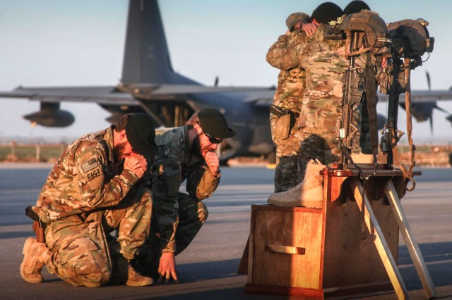 Soldiers of Special Forces of 10th Special Forces Group (Airborne) memorialize two of their fallen brothers during a memorial held at Kunduz Airfield in Afghanistan on Nov. 7, 2016. Maj. Andrew Byers, the commander, and Sgt. 1st Class Ryan Gloyer, an intelligence sergeant, were killed in action during the Battle of Boz Qandahari, Afghanistan, on Nov. 2-3, 2016.