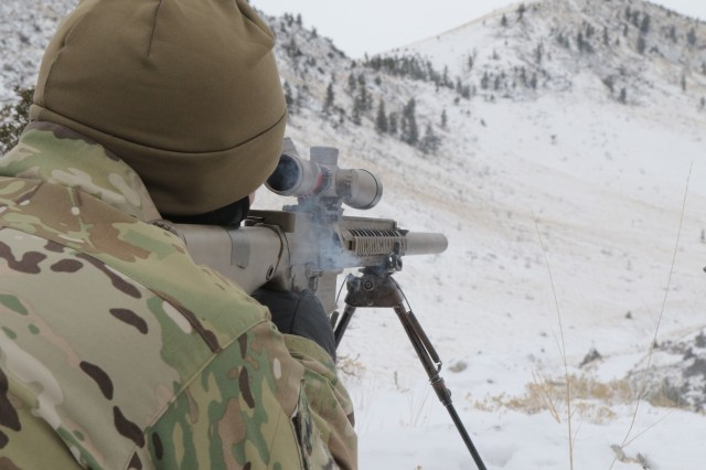 A Special Forces Operator assigned to 3rd Battalion, 10th Special Forces Group (Airborne) fires a round at a target hundreds of meters away during sniper training Feb. 8, 2017 at Limestone Hills Training Area at Fort Harrison, Montana. In addition to sharpening precision fire skills, soldiers with 10th SFG (A) honed their operational skills in ski and snowshoe movement across cold-weather terrain, and maintaining sustainment operations in an unimproved, austere environment.