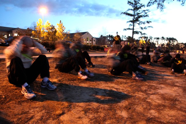 Paratroopers assigned to 6th Military Information Support Battalion, 4th Military Information Support Group, complete the sit-up portion of the unit's memorial physical training event honoring Spc. Marc Decoteau, Jan. 30, 2017. Unit leaders and Decoteau's brother, Lt. Andrew Decoteau, took time before and after the PT session to speak of their memories of the fallen Soldier, who was killed in action Jan. 29, 2010. The training consisted of one minute of silence to represent the month Decoteau was killed, 29 repetitions -- to represent the day -- of four different exercises -- to represent Decoteau's initial service commitment of four years -- 2010 meters of sprints to represent the year, and 19 burpees to represent his age.