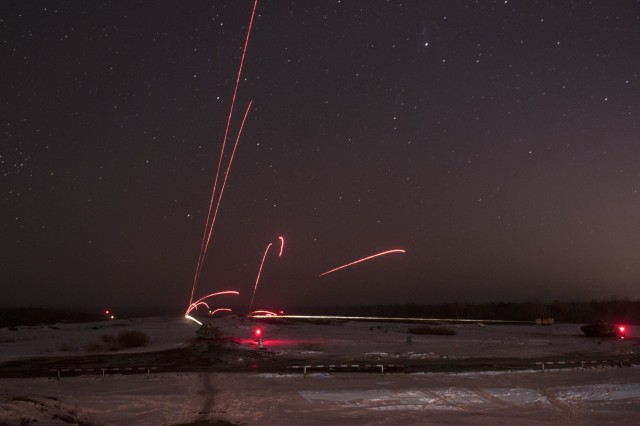 Ukrainian BMP-2s engage targets during night-fire familiarization at the International Peacekeeping and Security Center, near Yavoriv, Ukraine, on Feb. 16.