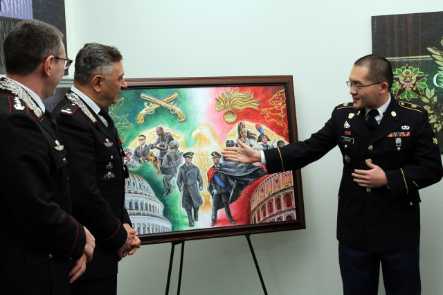 Army Spc. Zee H. Leung, right, a multimedia illustrator with the Army Multimedia and Visual Information Directorate at the Pentagon, painted a mural which highlights the relationship between the U.S. Army military police corps and the military police corps of the Italian military. Gen. Tullio Del Sette, center, who heads the Carabinieri Corps, accepts the portrait. The presentation took place in November 2016 at the Pentagon.