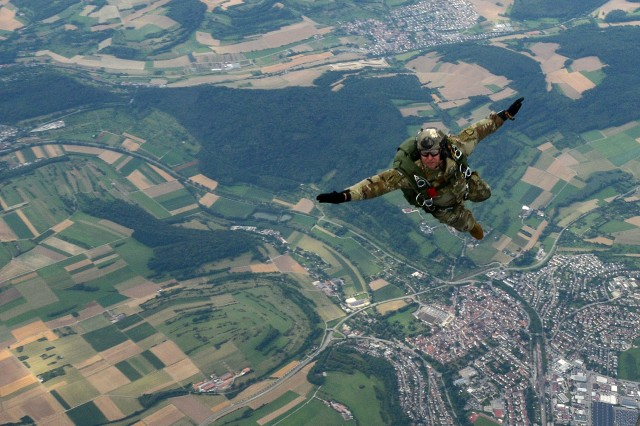 This photo of a Soldier free-falling from a Black Hawk helicopter over Germany during an airborne operations training exercise was one of several dramatic photos taken throughout 2016 that earned Visual Information Specialist Jason Johnston, from 7th Army Training Command, the title of Civilian Photographer of the Year in the U.S. Army Europe level Keith L. Ware Public Affairs Competition.