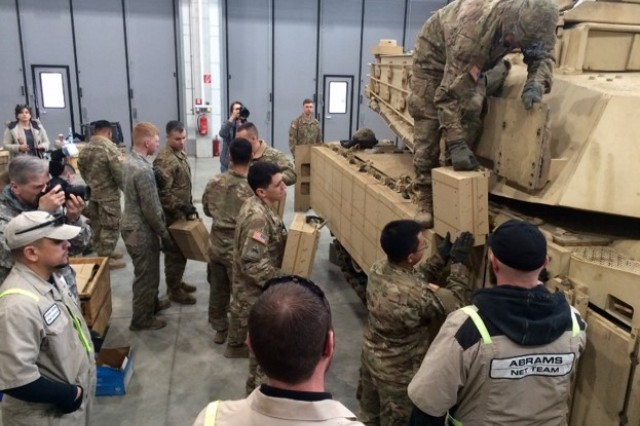 Tank and maintenance crews with 1st Battalion, 66th Armor Regiment, 3rd Armored Brigade Combat Team, 4th Infantry Division, install M1A2SepV2 Abrams reactive armor tiles (ARAT) at the 7th Army Training Command's Grafenwoehr Training Area, Germany, Feb. 28, 2017. The installation of the ARAT will enhance the tank's defensive capabilities, providing a greater deterrent against aggression as the 3rd ABCT maintains a persistent presence in central and eastern Europe as the rotational ABCT for Atlantic Resolve. (U.S. Army photo by Ch. (Capt.) Malcolm Rios, 3rd ABCT Public Affairs, 4th Inf. Div.)