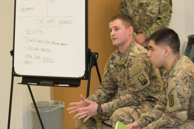 LANDSTUHL, Germany - Sgt. Michael A. Bivens, 21st Theater Sustainment Command and Spc. Eligio Camacho brief thier group's unit assessment at training by the U.S. Army Medical Department Center and School Combat and Operational Stress Control Mobile Training Team on Mar. 2, 2017. (U.S. Army photo by Capt. Jerome Ferrin, 30th Medical Brigade Public Affairs)