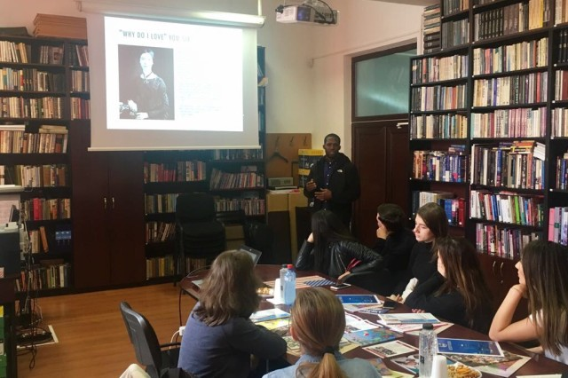 Sgt. Malcolm Cohens-Ashley, an automations clerk with Headquarters and Headquarters Company, 1st Battalion, 8th Infantry Regiment, 3rd Armored Brigade Combat Team, 4th Infantry Division, gives a poetry lesson and reading to students from Ovidius University of Constanta in Constanta, Romania, March 3, 2017. Soldiers from 1st Bn., 8th Inf. Regt., have emphasized community outreach while participating in Atlantic Resolve to collectively train with Romanian Defense Forces and strengthen the credible deterrent capabilities available in southeastern Europe.