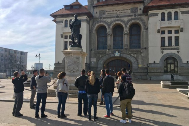 Soldiers of 1st Battalion, 8th Infantry Regiment, 3rd Armored Brigade Combat Team, 4th Infantry Division, learn about the history of the Roman poet and philosopher Ovidius during a cultural tour of Constanta, Romania, led by local youth scouts on March 4, 2017. The battalion has emphasized community outreach as it participates in Atlantic Resolve to collectively train with Romanian Defense Forces and strengthen the credible deterrent capabilities available in southeastern Europe.