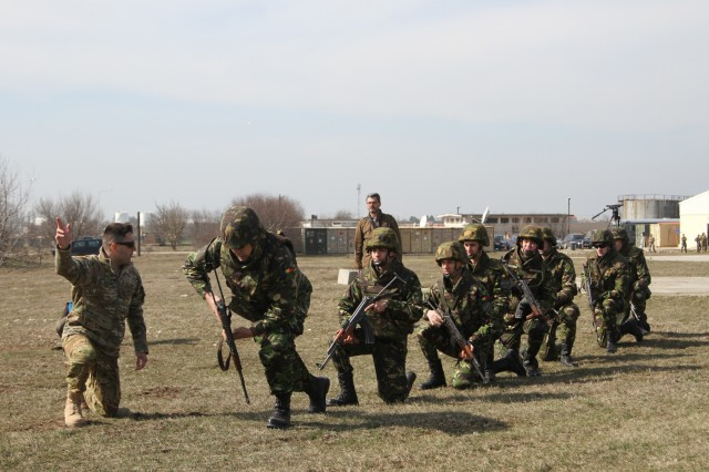 Romanian Army soldiers attached to the Military Police Company, Mihail Kogalniceanu Air Base race to a UH-60 Black Hawk helicopter upon receiving commands from their U.S. Army instructor, March 8, 2017. The combined training between the Romanian forces and the Fort Drum, N.Y.-based 2-10 Assault Helicopter Battalion, 10th Combat Aviation Brigade focused on the challenges involved in successfully performing air assault operations. The Romanian-U.S. collaboration during the exercise is an integral part of the larger Operation Atlantic Resolve, a multi-nation effort between the United States and her Allies and partners that enhances regional stability and deters aggression across eastern Europe. (U.S. Army photo by PV2 Nick Vidro, 7th Mobile Public Affairs Detachment)