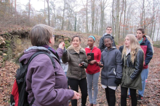 Caecilia Kastl-Meier, staff member, Environmental Division, shows Vilseck High School students a mummified Zwergfledermaus, or common pipistrelle, bat during a tour of the Grafenwoehr Training Area.