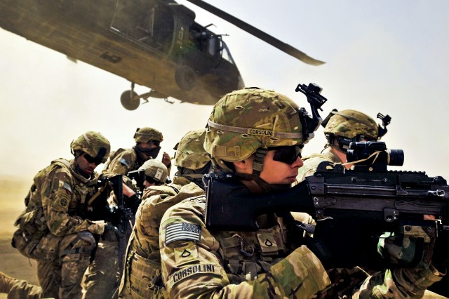 Pfc. Samuel Corsolini, a gunner assigned to F Company, 2nd Battalion, 25th Aviation Regiment, 25th Combat Aviation Brigade, pulls security with other Pathfinders as a UH-60 Black Hawk helicopter takes off after unloading his team and members of 2nd Afghan National Civil Order Patrol Special Weapons And Tactics Team during a vehicle interdiction as part of Operation Pranoo Verbena in order to disrupt Taliban operations in Kandahar province, Afghanistan, March 16, 2012.