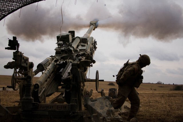 Spc. Vincent Ventarola, the #1 man for the gun crew of 1st Section, 1st Platoon, Cobra Battery, Field Artillery Squadron, 2d Cavalry Regiment, U.S. Army, pulls the trigger of a M777A2 Howitzer during a fire mission March 8, 2017 in the Grafenwoehr Training Area, Germany. The Squadron participated in Dynamic Front II March 6-9, 2017. The exercise enabled the U.S., Germany and Czech Republic to synchronize their artillery capabilities.